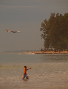 A aeroplane approaches the runway at Phuket Airport, Nai Yang Beach